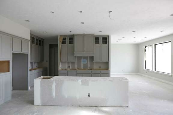 A kitchen under construction in a home Wednesday, Feb. 13, 2019, in Katy.