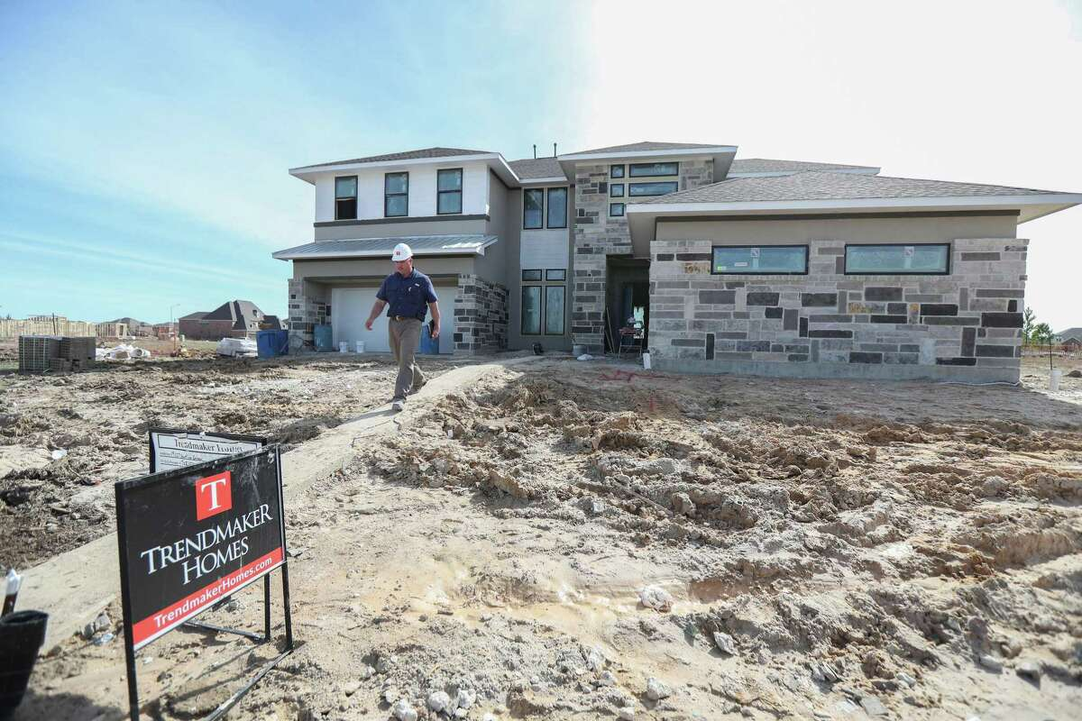 Builder Rob Pinckard walks out of home that is under construction that has been designed to lower the cost of materials used to build it Wednesday, Feb. 13, 2019, in Katy.