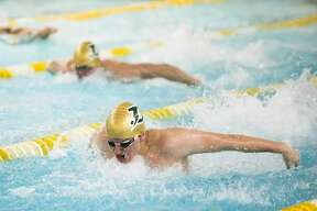 Dow's Gage Bunker competes in the 200 yard medley during a meet against Midland on Thursday, Feb. 14, 2019 at H. H. Dow High School. (Katy Kildee/kkildee@mdn.net)
