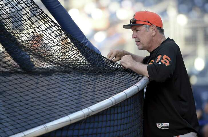 San Francisco Giants' Bruce Bochy looks on during batting practice before the baseball game against the San Diego Padres Monday, July 30, 2018, in San Diego. (AP Photo/Orlando Ramirez)