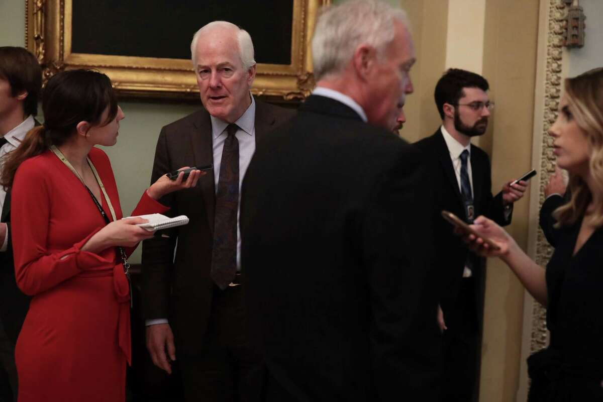 WASHINGTON, DC - FEBRUARY 05: U.S. Sen. John Cornyn (R-TX) (2nd L) speaks to members of the media as he arrives at a weekly Senate Republican Policy Luncheon at the U.S. Capitol February 5, 2019 in Washington, DC. Senate GOPs held the weekly policy lunch to discuss Republican agenda. (Photo by Alex Wong/Getty Images)