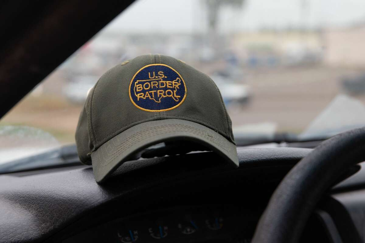 This photo shows a US Border Patrol hat sitting on dashboard of a Customs and Border Protection vehicle in McAllen, Texas, on January 15, 2019. (Photo by SUZANNE CORDEIRO / AFP) (Photo credit should read SUZANNE CORDEIRO/AFP/Getty Images)