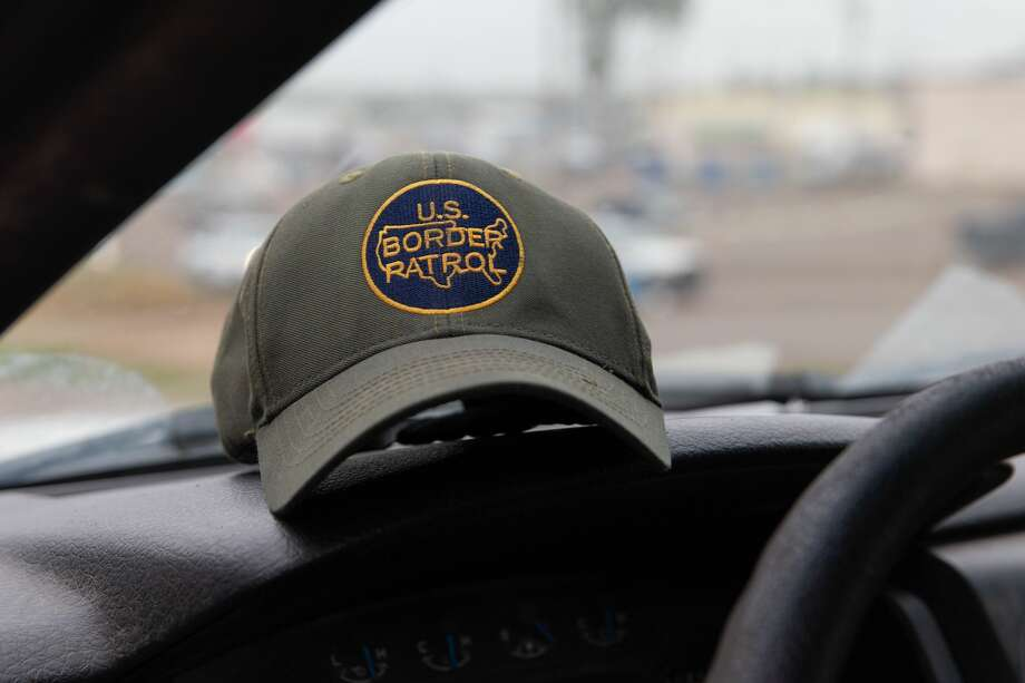 31524cbc1bb FILE-- This photo shows a US Border Patrol hat sitting on the dashboard of