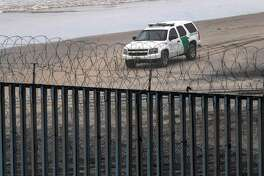 A Border Patrol unit remains near a section of reinforced US-Mexico border fence seen from Tijuana, Baja California state, Mexico, on February 14, 2019. - US President Donald Trump will sign a spending bill to avert a government shutdown but will also issue an emergency declaration to fund his controversial border wall, the White House and lawmakers said Thursday. (Photo by Guillermo Arias / AFP)GUILLERMO ARIAS/AFP/Getty Images