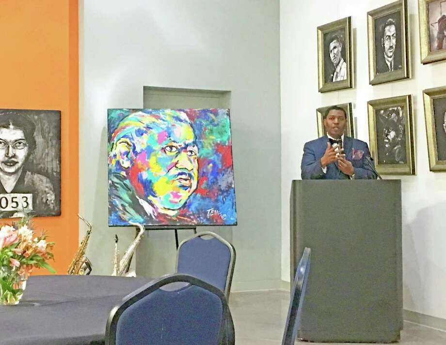 Sam Collins III, historian and art collector, served as guest speaker at a recent art exhibition opening in Missouri City.