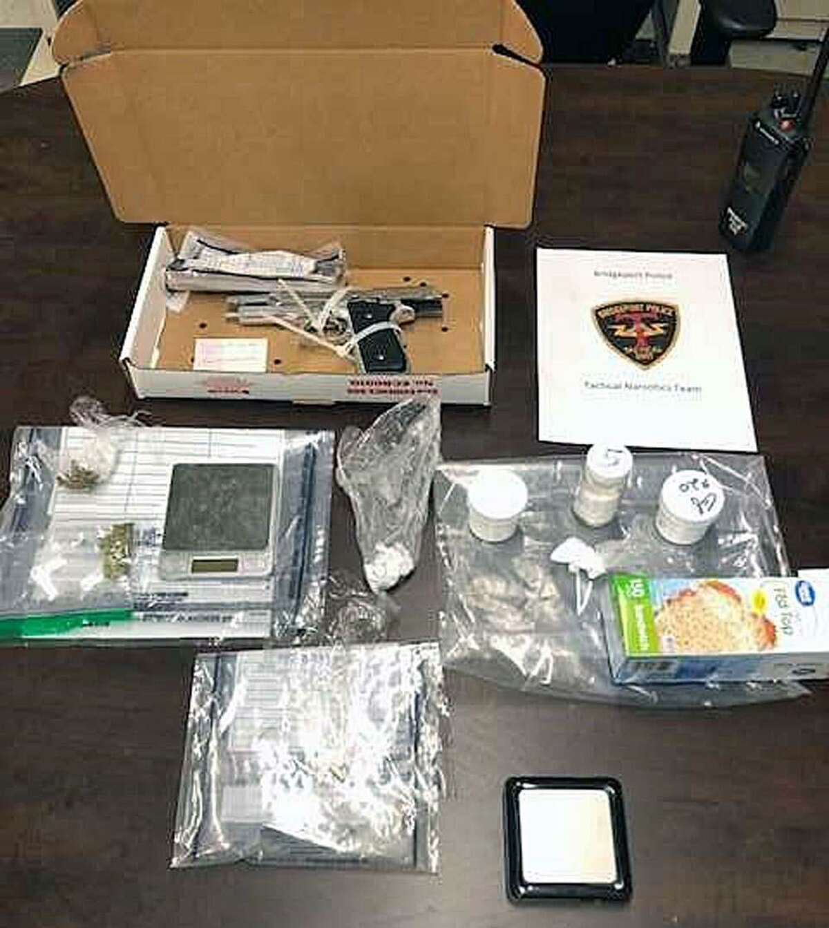 Items seized by the Bridgeport, Conn., Police Department's Tactical Narcotics Team during a recent arrest in the city.