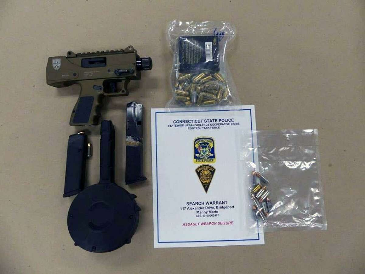 A search in Bridgeport, Conn., led police to a stolen gun, a 50-round drum, a .30-round extended magazine and 67 rounds of ammunition on Feb. 14, 2019.