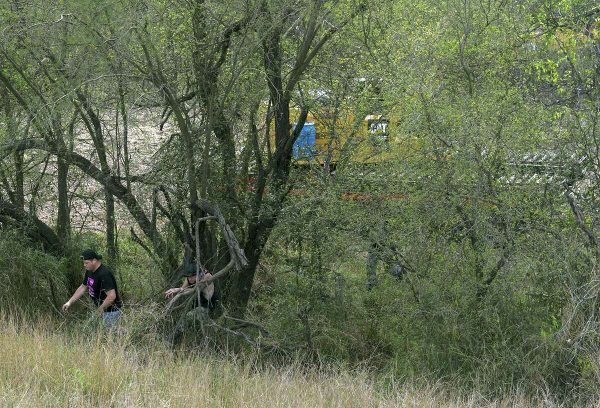 Activists walk out of an area where they say equipment is being used to start the construction of the border wall in Mission, Tex. on Feb. 14, 2019. Veronica G. Cardenas/Contributor