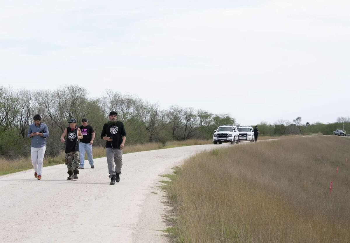 Police escorts activists and journalists out of an area where they say vegetation is being tear down for the construction of the border wall in Mission, Tex. on Feb. 14, 2019. Veronica G. Cardenas/Contributor