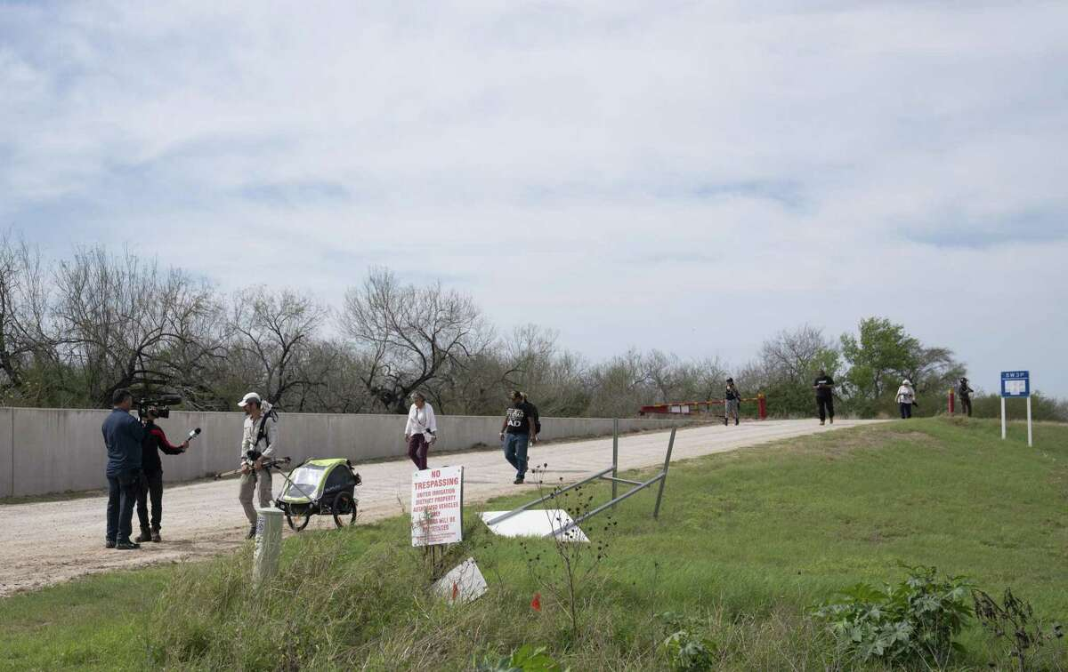 Activists and Carrizo/Comecrudo Tribe of Texas members are escorted out of the land adjacent to Bentsen Rio Grande Valley State Park by the police in Mission, Tex. on Feb. 14, 2019. The activists and tribe members were escorted back to the park after they tried walking to the area where they say vegetation is being tear down for the construction of the border wall. Veronica G. Cardenas/Contributor