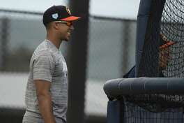 Houston Astros left fielder Michael Brantley watches other left handed hitters practice at Fitteam Ballpark of The Palm Beaches on Day 1 of spring training on Thursday, Feb. 14, 2019, in West Palm Beach.