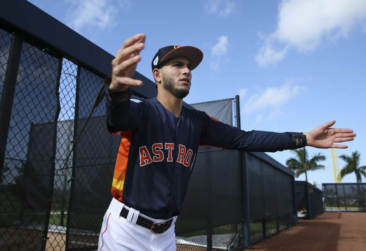 Houston Astros left handed pitcher Cionel Perez stretches during warm up at Fitteam Ballpark of The Palm Beaches on Day 1 of spring training on Thursday, Feb. 14, 2019, in West Palm Beach.