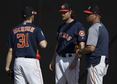 Houston Astros right handed pitchers Collin McHugh (31) and Gerrit Cole (45) talk to bullpen coach Josh Miller after pitching at Fitteam Ballpark of The Palm Beaches on Day 1 of spring training on Thursday, Feb. 14, 2019, in West Palm Beach.