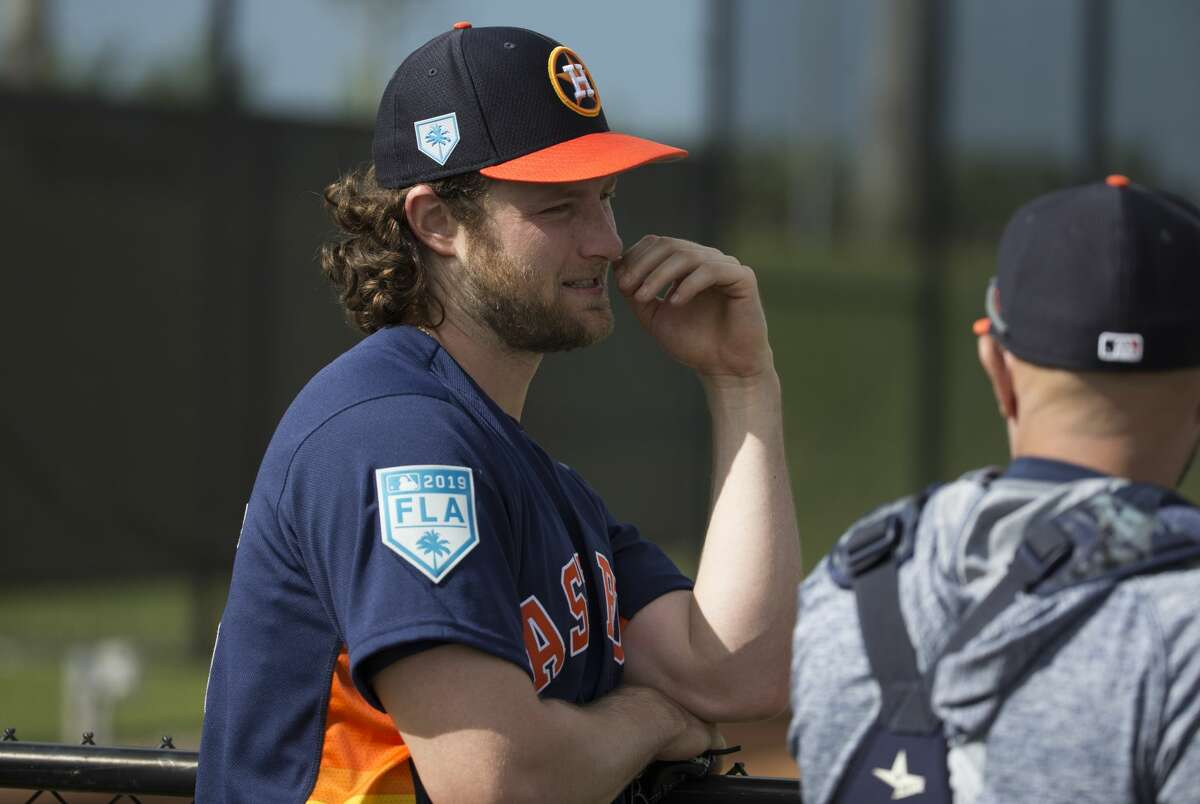 Houston Astros right handed pitcher Gerrit Cole (45) hangs around bullpen and talks to bullpen catcher Javier Bracamonte (85) after pitching at Fitteam Ballpark of The Palm Beaches on Day 1 of spring training on Thursday, Feb. 14, 2019, in West Palm Beach.