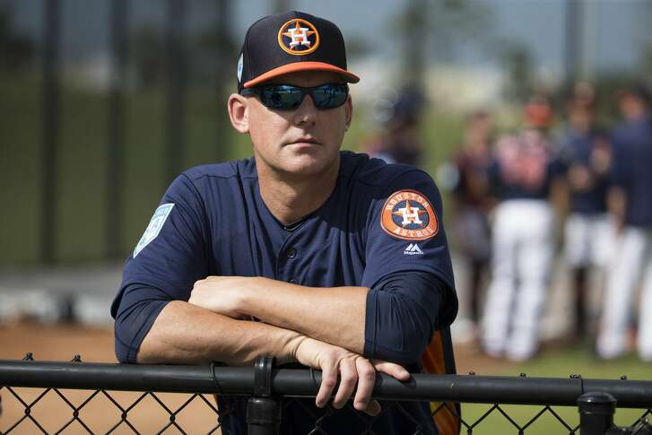 Houston Astros manager AJ Hinch watches practice at Fitteam Ballpark of The Palm Beaches on Day 1 of spring training on Thursday, Feb. 14, 2019, in West Palm Beach.