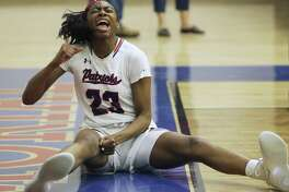 Patriot forward Sahara Jones pumps her fist after scoring and drawing a foul as Veterans Memorial hosts Edison in 5A second-round girls basketball playoff action at Veterans Memorial High School gym on February 14, 2019.