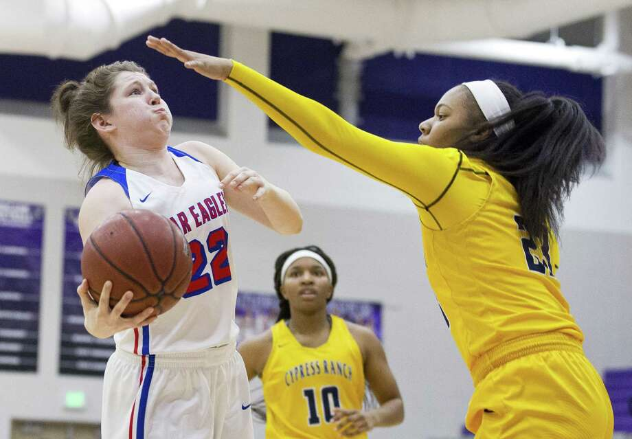 Oak Ridge forward Devan Caldwell (22) shoots as Cypress Ranch point guard Lauren McWhite (21) defends during the first quarter of a Region II-6A area high school basketball playoff game at Klein Cain High School, Thursday, Feb. 14, 2019, in Houston. Photo: Jason Fochtman, Houston Chronicle / Staff Photographer / © 2019 Houston Chronicle