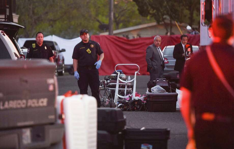 Laredo firefighters look on after human remains were found inside a bucket at an apartment Thursday at Santa Rita Avenue and Jefferson Street. Photo: Danny Zaragoza /Laredo Morning Times