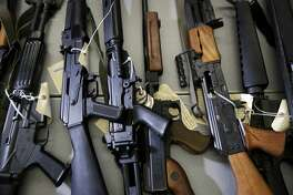 Illegally possessed firearms seized by authorities are shown at a news conference in Los Angeles Tuesday, Oct. 9, 2018. Officials say a new police task force targeting people who aren't allowed to have guns has led to the arrest of 35 people and the seizure of more than 100 firearms since June, 2018. California Attorney General Xavier Becerra touted the Los Angeles task force's work at the news conference Tuesday but acknowledged that an ever-increasing backlog of prohibited possessors remains. (AP Photo/Jae C. Hong)