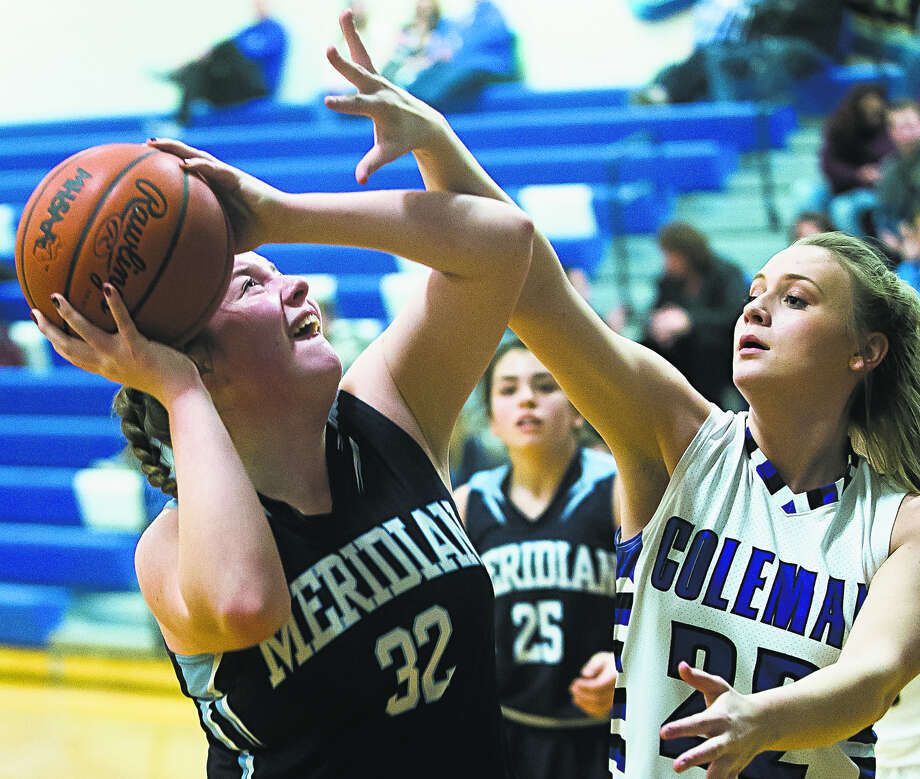 Meridian's Audrey Kielpinski tries to muscle up a shot against Coleman in a game earlier this season. Kielpinski had 20 points and 11 rebounds, both game highs, on Thursday as the Mustangs' big fourth-quarter rally against Farwell came up just short. Photo: Daily News File Photo