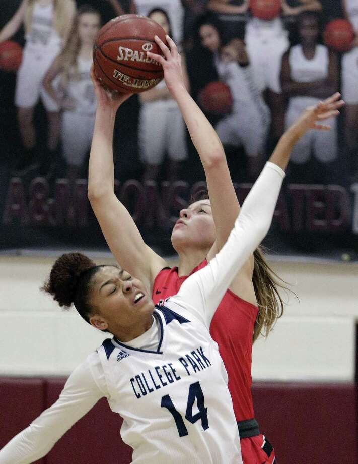 College Park's Sandra Cannady (14) battles for a rebound with Vista Ridge's A.J. Marotte, back, during their playoff game Thursday, Feb. 14, 2019 at A&M Consolidated High School in College Station, TX. Photo: Michael Wyke, Houston Chronicle / Contributor / © 2019 Houston Chronicle