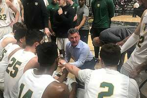 USF head coach Kyle Smith talks to his team during a first-half timeout of a game against Pepperdine.