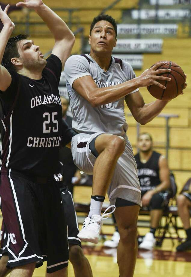 TAMIU guard Xabier Gomez scored 20 points but the Dustdevils lost 89-64 to Oklahoma Christian in their worst defensive outing of the year on Thursday night. Photo: Danny Zaragoza /Laredo Morning Times