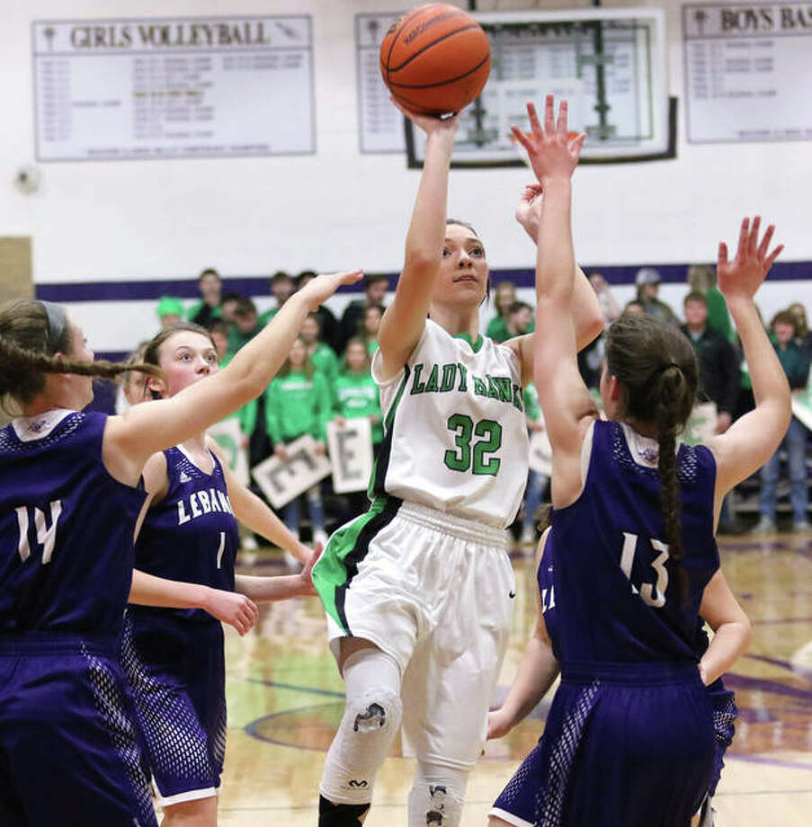 Carrollton's Marley Mullink (32) puts up a shot in the lane over Lebanon's Grace Krumsieg (right) and Abigail Reinneck (14) during the Hawks' semifinal win Monday at the Jacksonville Class 1A Routt Sectional. Mullink ended her prep career with a loss Thursday night. Photo: Greg Shashack / The Telegraph