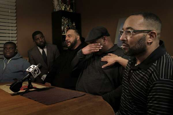 Marc McCoy (second from right) becomes emotional while recalling his brother, Willie McCoy.