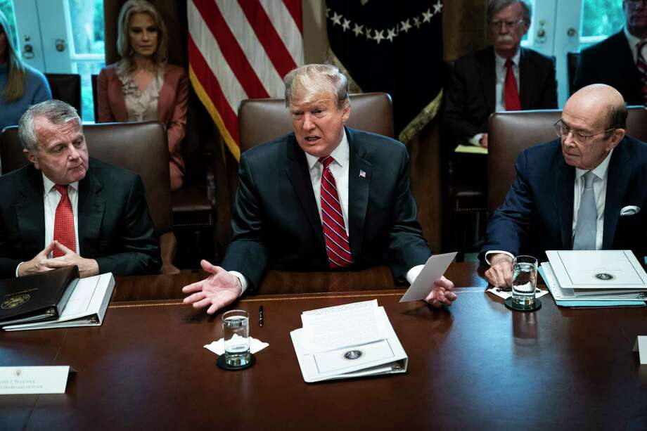President Donald Trump, above in a meeting at the White House on Tuesday, refused to sign the spendingbill Thursday until the White House Counsel's Office convinced him it would not preclude him from declaring a national emergency, two senior administration officials said. Photo: Washington Post Photo By Jabin Botsford / The Washington Post