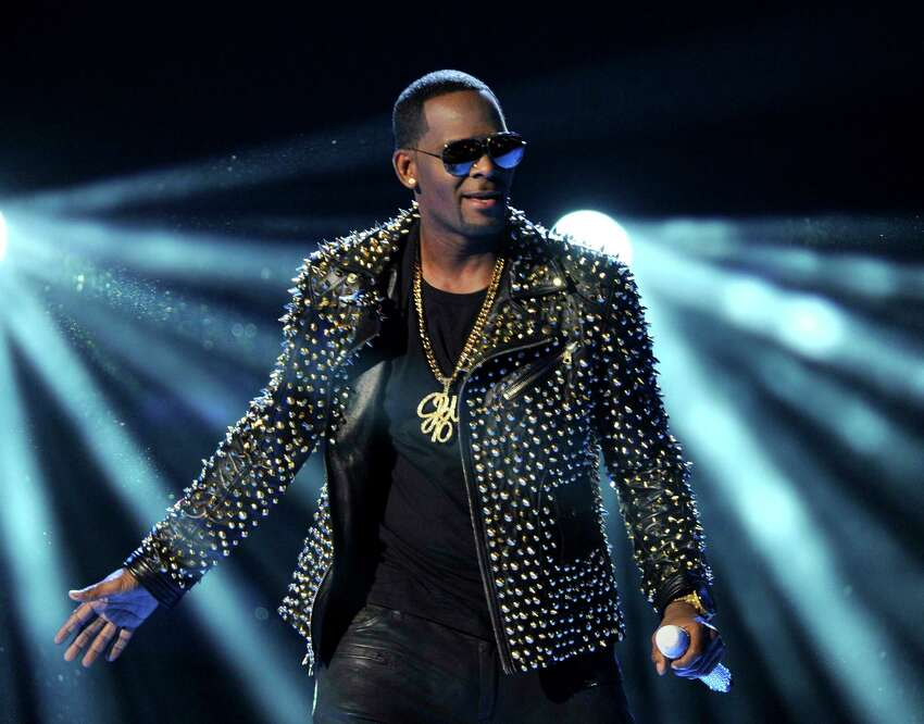FILE - In this June 30, 2013 file photo, R. Kelly performs at the BET Awards in Los Angeles. Attorney Michael Avenatti says he has new video evidence of singer R. Kelly having sex with an underage girl. Avenatti said Thursday, Feb. 14, 2019, he has turned over the video to prosecutors in Chicago. Avenatti says the video is not the same evidence used in Kelly's 2008 trial, when he was acquitted on all charges of child pornography. (Photo by Frank Micelotta/Invision/AP, File)