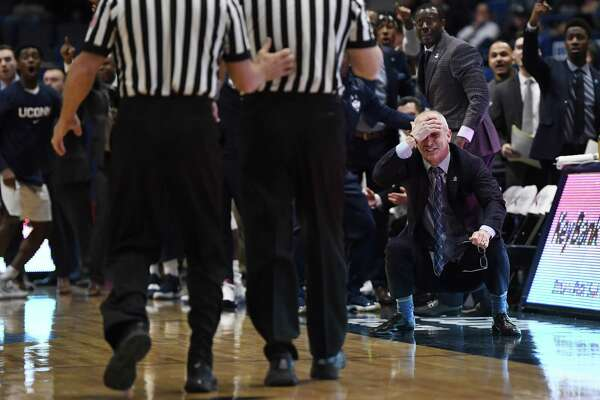 UConn coach Dan Hurley, front right, reacts to an official's call against Houston on Thursday.