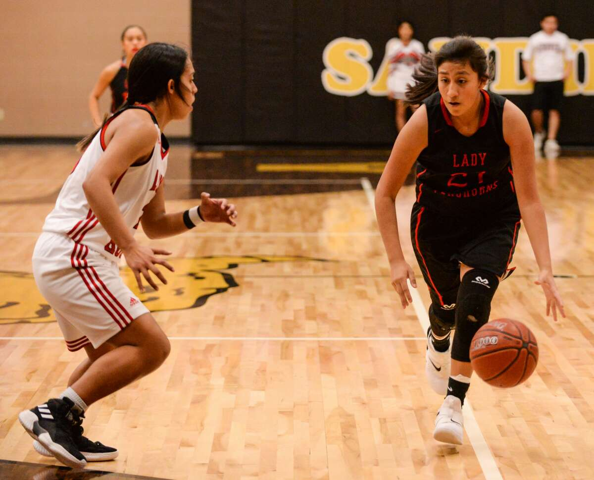 Lockney's Gabby Cervantez (21) drives to the court during the 2A area playoff game against Gruver Thursday, Feb. 14, 2019 at Amarillo High School.