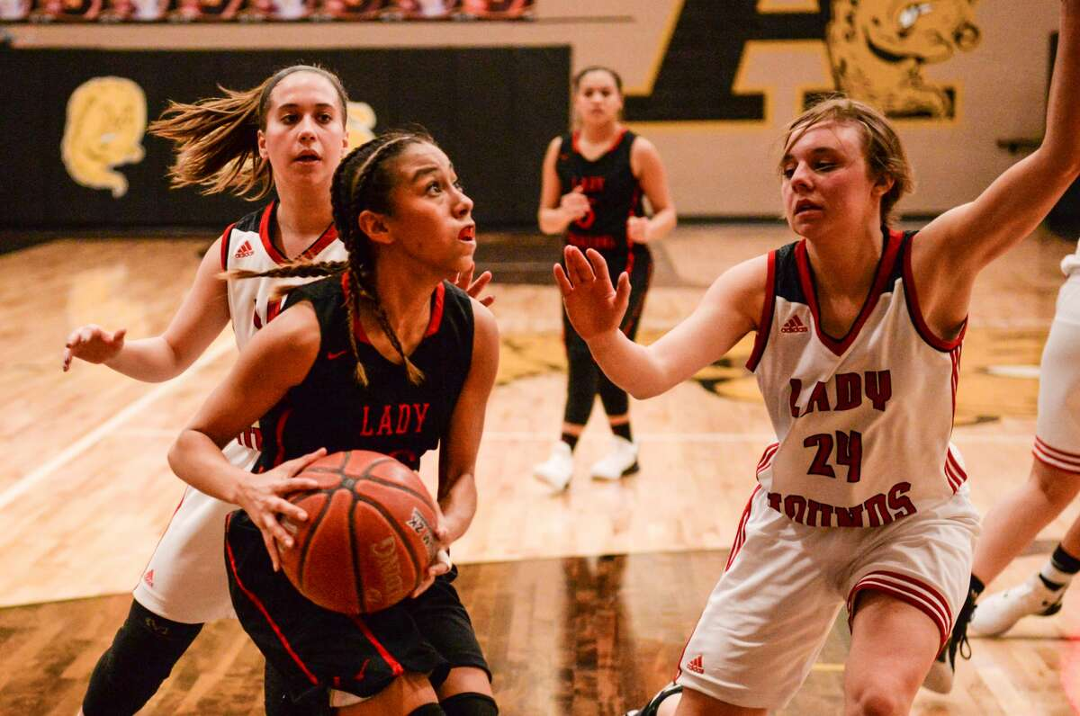 Lockney's Reagan Nuncio (10) pauses before shooting for two against Gruver's Marlie Kelp (24) during the 2A area playoff game Thursday, Feb. 14, 2019 at Amarillo High School.