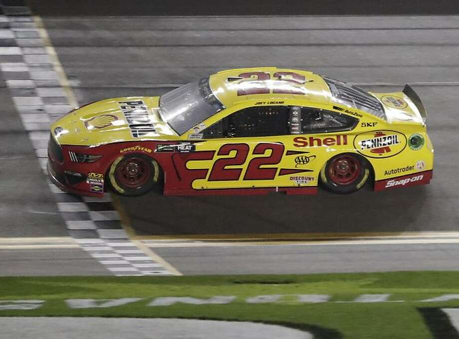 Joey Logano crosses the finish line to win the second of two qualifying auto races Thursday for Sunday's NASCAR Cup Series Daytona 500. Photo: John Raoux / Associated Press / Copyright 2019 The Associated Press. All rights reserved