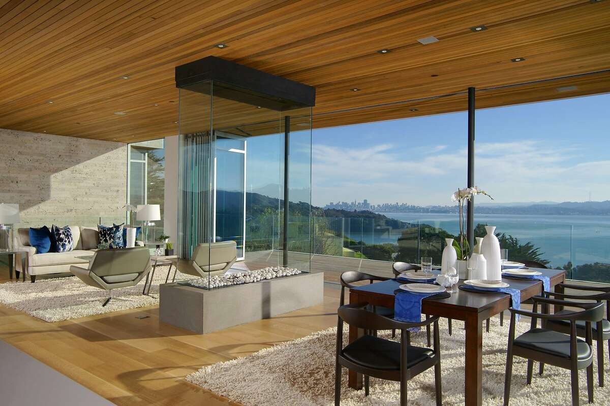 The light-filled main level at 1860 Mountain View Drive in Tiburon revolves around a custom four-sided suspended glass fireplace with a 24-inch open reveal.