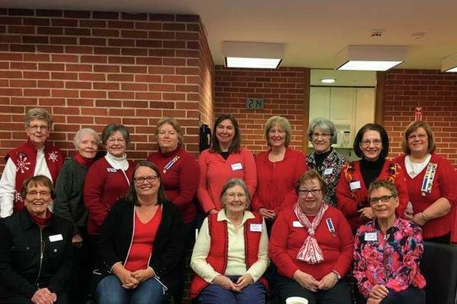 Attendees wear red during the February meeting of The John Alden Chapter, Daughters of the American Revolution. (Photo provided/DAR)
