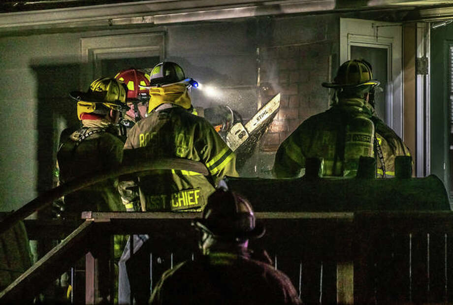 Firefighters from Bethalto, Cottage Hills and Rosewood Heights responded early Friday to a sudden, immedediately unexplained fire on the back deck of a home in the 200 block of East Airline Drive in East Alton. The first call came after 2 a.m. An individual at the property said the deck, located behind the home, was on fire and smoke was filling the home. There did not appear to be any injuries and damage to the home appeared to be minor. Official reports were not immediately available. Photo: Nathan Woodside | The Telegraph