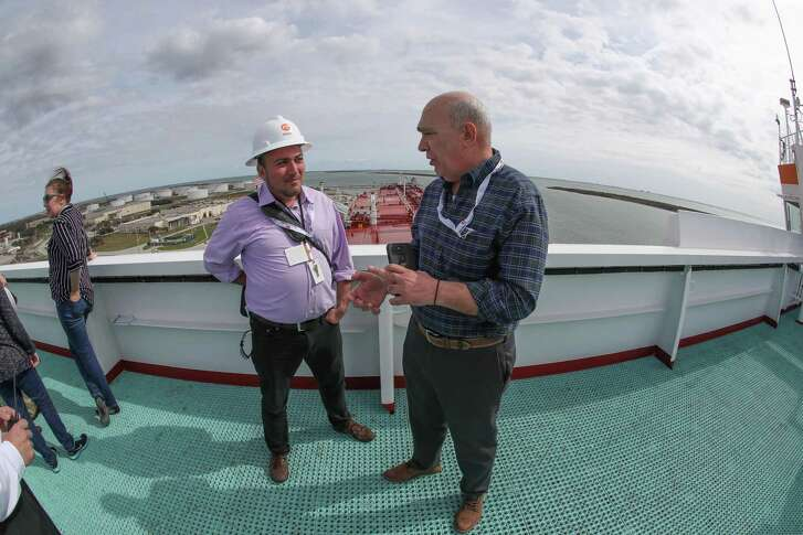 """The Houston Chronicle takes a look at life aboard a Very Large Crude Carrier. Houston Chronicle reporter Sergio Chapa, center, speaks with EuroNav representative Panos Pippos during a January 25, 2019 visit aboard """"The Aral,"""" a VLCC tanker that was docked at the Moda Midstream crude oil export terminal in Ingleside."""