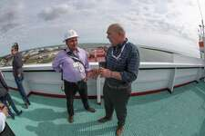 "The Houston Chronicle takes a look at life aboard a Very Large Crude Carrier. Houston Chronicle reporter Sergio Chapa, center, speaks with EuroNav representative Panos Pippos during a January 25, 2019 visit aboard ""The Aral,"" a VLCC tanker that was docked at the Moda Midstream crude oil export terminal in Ingleside."