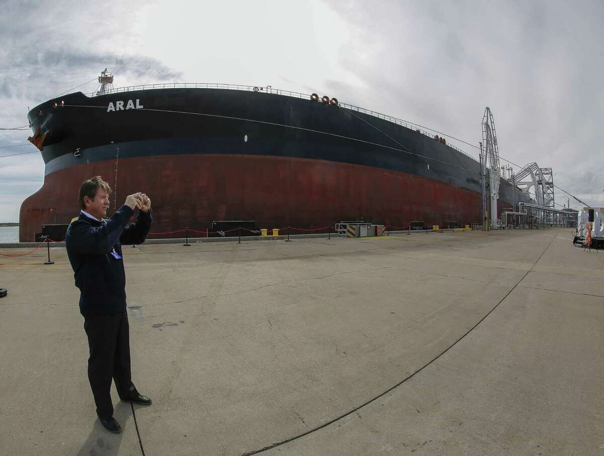 Aral ship captain Andrey Losev takes photos of the Commissioning ceremony at the Moda Midstream LLC Friday, Jan. 25, 2019, in Ingleside.