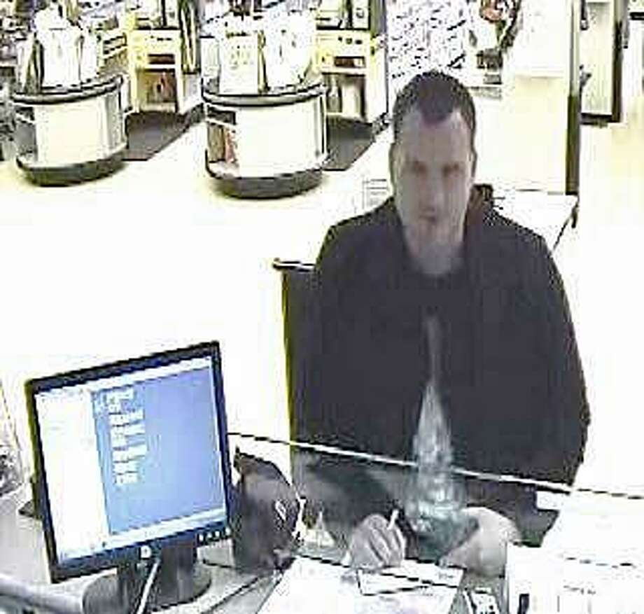Vernon police are looking for the man who made $37,700 in withdrawals by posing as another individual at a People's United Bank in a Stop & Shop. The man made four, in-person withdrawals totaling more than $37,000 at the bank branch located within the Pitkin Road Stop & Shop over a two-day period, Lt. William Meier said. Photo: Vernon Police Photo
