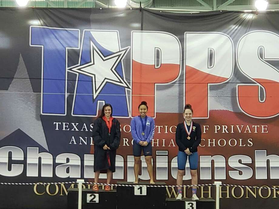 Frassati Catholic's Lauren Lacson, center, won gold in the 200 individual medley and gold in the 100 breaststroke at the TAPPS Division II State Championships hosted at the Mansfield ISD Natatorium, Feb. 7. Photo: Frassati Catholic