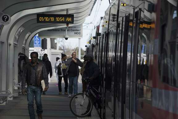 Passengers get off a METRO Red Line train at Houston Community College Northline Campus on Thursday, Jan. 10, 2019, in Houston. METRO plans to extend it to North Shepherd Park and Ride.