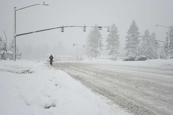 Snow: I-80 to Tahoe, Hwy  50 reopened, chains required