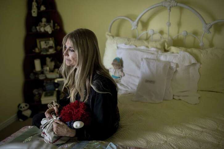 Gwen Casados sits in her daughter's room in Houston. Her daughter, Heather Schneider, was sexually assaulted inside Second Baptist Church in Houston in 1993.