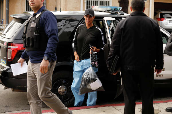Shooting victim Zhoie Perez, 45, is released by Los Angeles police officers after being interviewed about the shooting incident involving a security guard with the Etz Jacob Congregation/Ohel Chana High School on Beverly Boulevard in the Fairfax District of Los Angeles on Thursday, Feb. 14, 2019. Perez, with First Amendment Auditors, said she was filming outside the synagogue and was confronted by the security guard. Perez said she was shot by the guard, with the bullet grazing her upper right leg. (Genaro Molina/Los Angeles Times/TNS)