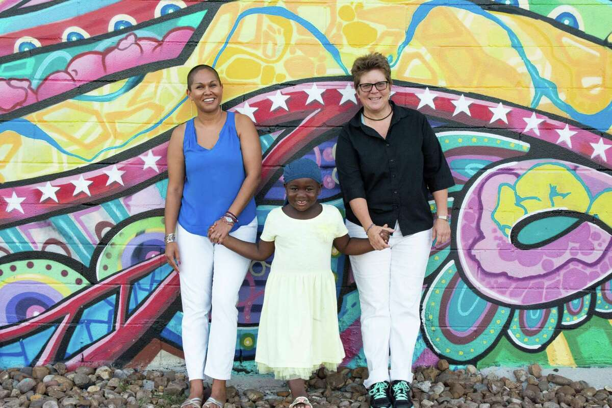 """Author Nishta Mehra, left, wrote """"Brown, White, Black"""" about her family, gender-fluid son Shiv and wife Jill."""