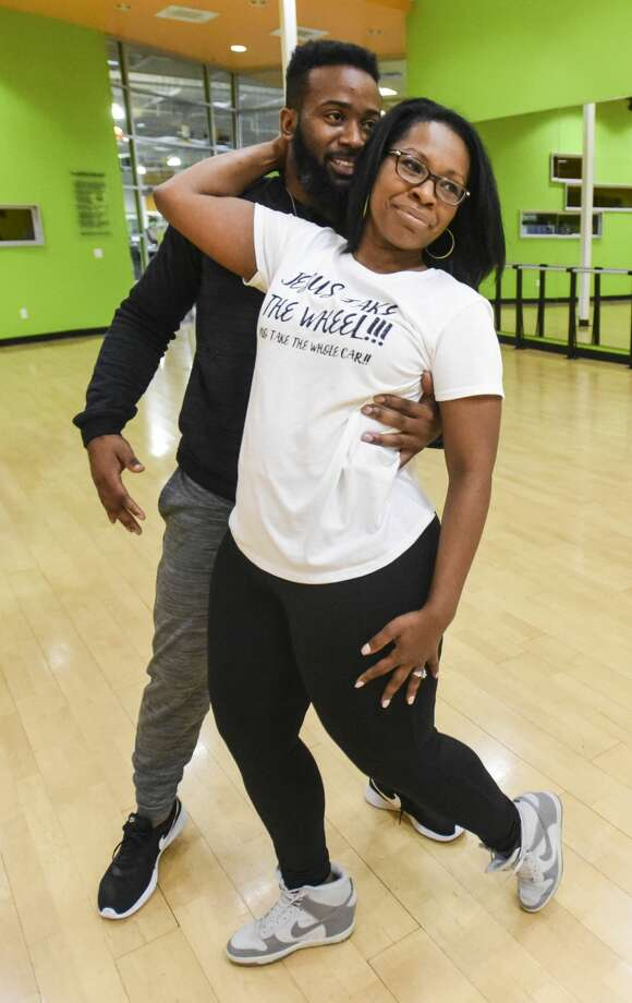 Fred Vernon and LaSan Gilder practice with their coach Robin Heniger for Dancing with the Stars at Exogyn on Wednesday.  Photo taken on Wednesday, 2/13/19.  Ryan Welch/The Enterprise Photo: Ryan Welch/The Enterprise