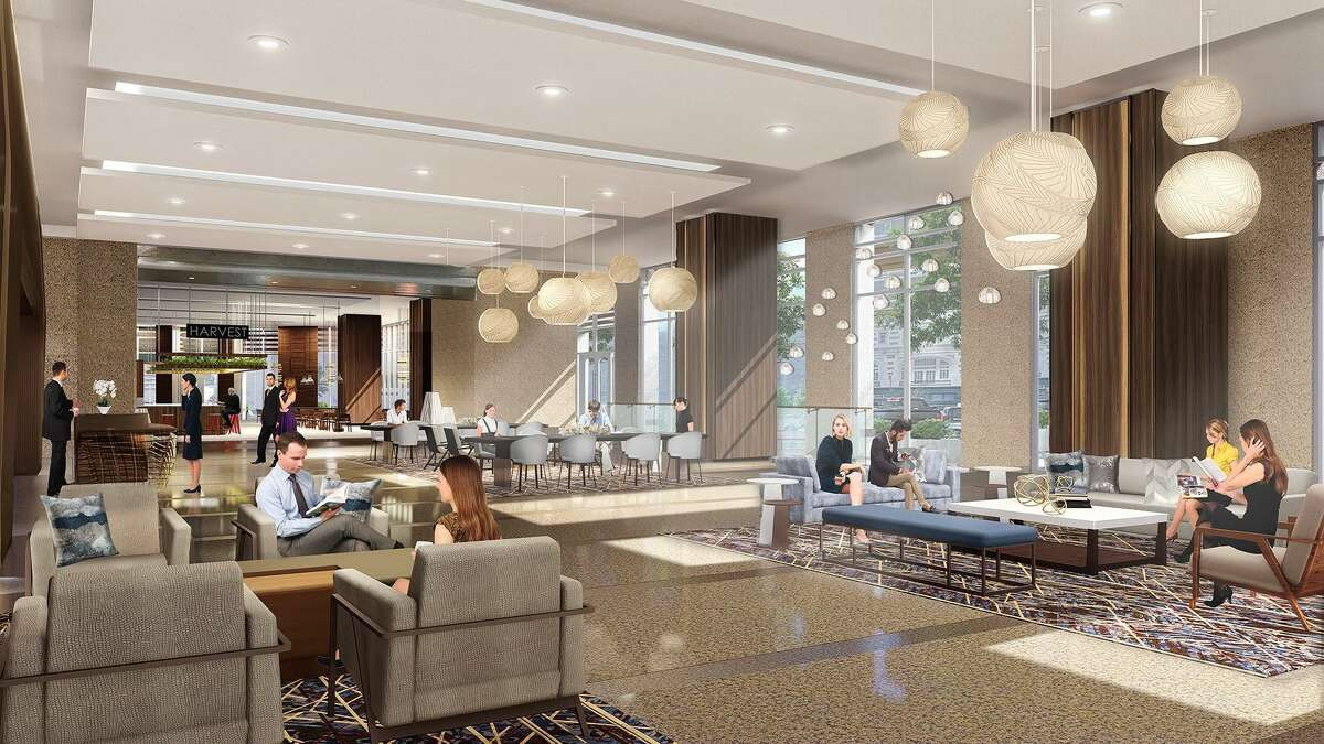 Renovations of the lobby at 717 Texas in downtown Houston are under way. A rendering shows new seating areas, furniture and lighting.